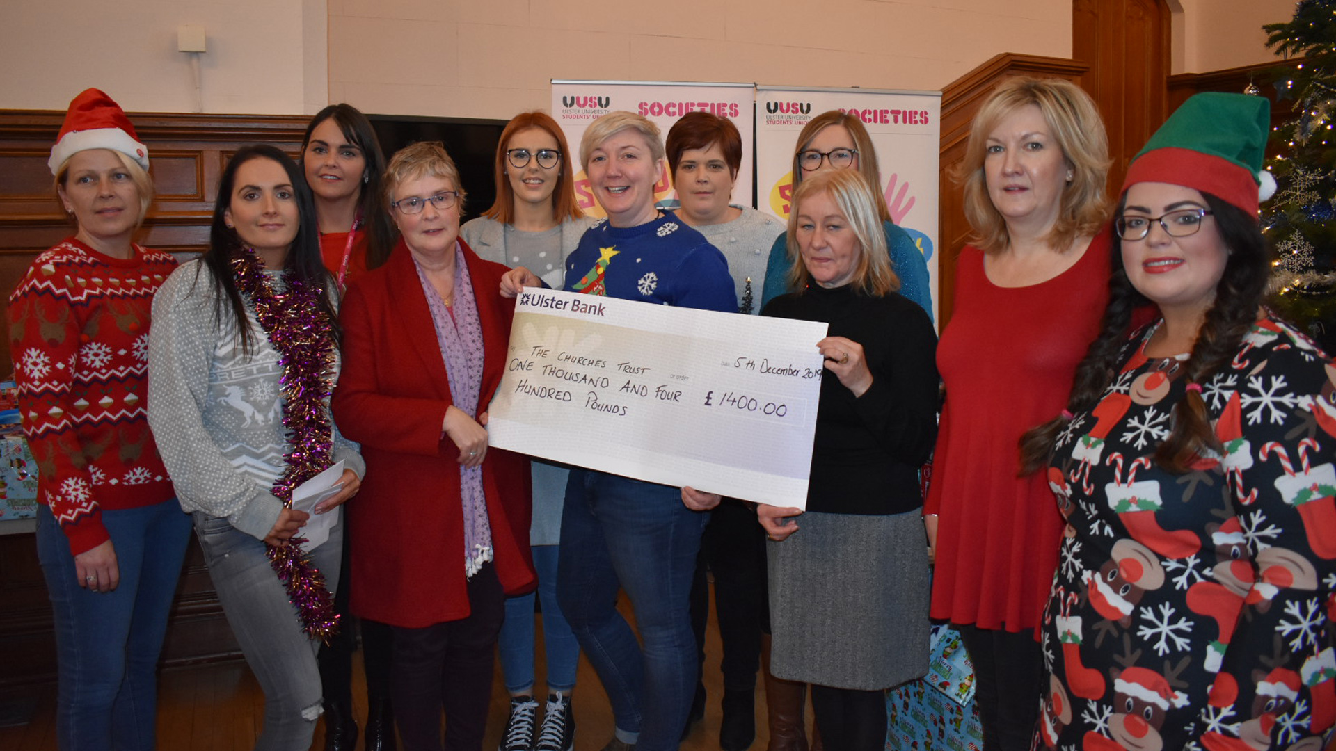 staff-and-social-work-students-presenting-cheque-for-1400-to-churches-trust-
